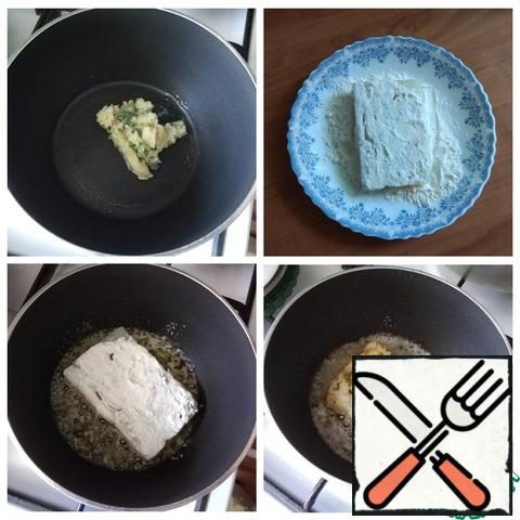 Frozen flavored butter-sauce is spread in a frying pan. Melt it and spread the fish rolled in flour. It is necessary that the sauce is about 2 cm at the bottom of the pan and the fish is fried as in a deep-fry. It's fast for a couple of minutes on each side. The sauce is allowed to burn slightly.