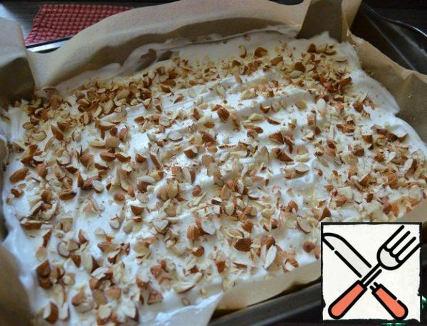 Chop the almonds with a knife. Scatter over the meringue.