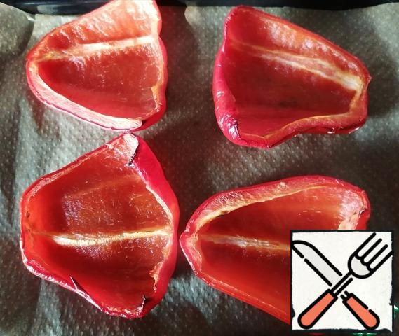 Cut the pepper in half, remove the seeds and bake in the oven at a temperature of 220 degrees for 20 minutes.
