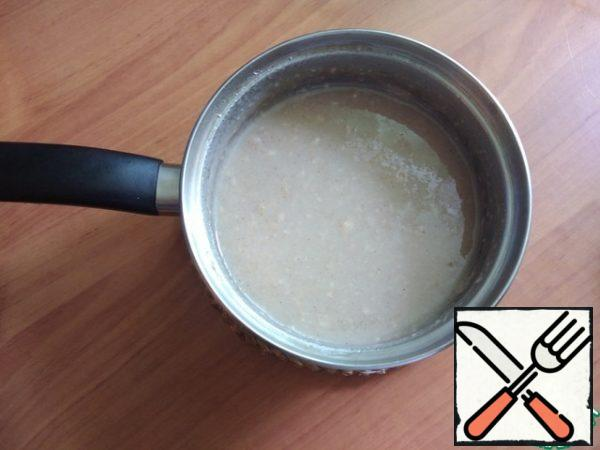 Pour the finished syrup in a thin stream into the milk, stirring constantly. Mix well.