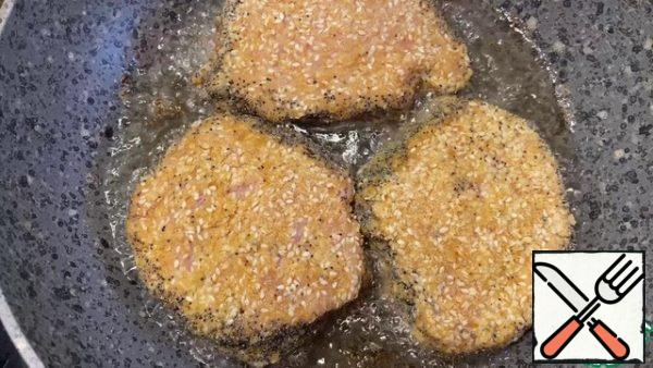 Fry the meat on both sides in vegetable oil until golden brown.