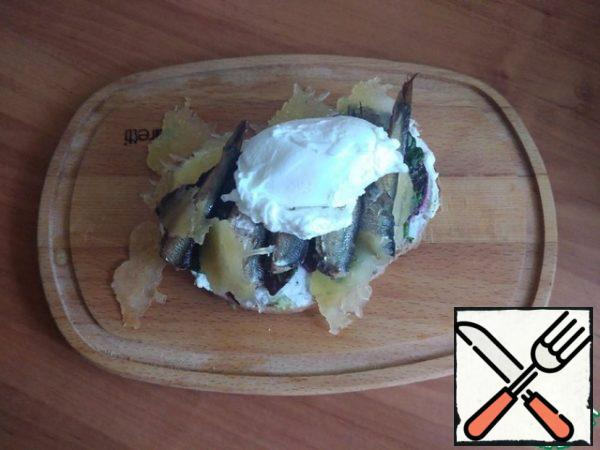 We put a poached egg on the sprats.