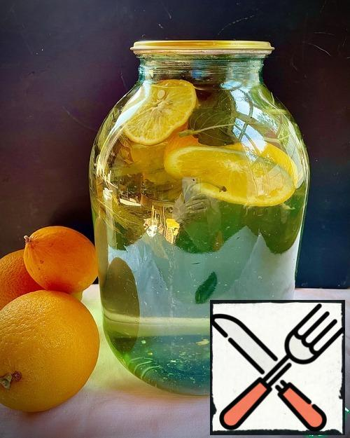 I give the proportion for one three-liter jar. Wash the orange and lemon, cut into thin circles. Wash the mint, cut off the leaves. Sterilize the jars and lids. Pour sugar into the jar. Put the mint leaves, lemon and orange slices. Pour boiling water over it. Close the jars and shake them well so that the sugar will disperse. Ready for use in 1.5 months.