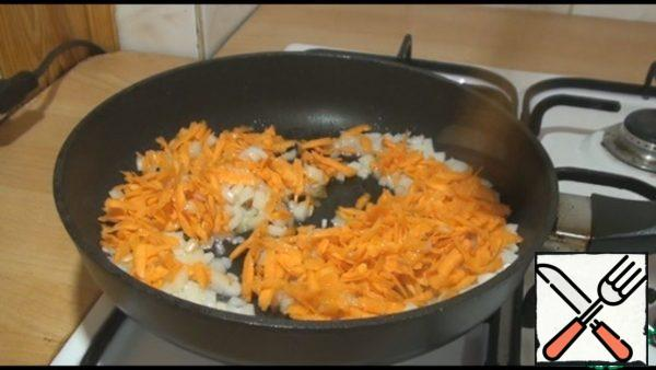 Add the carrots, fry for another 5 minutes.