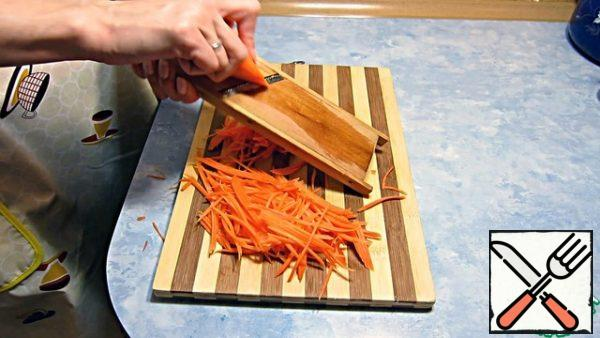 While the marinade cools, rub the carrots.