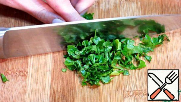 We chop the greens not very finely.