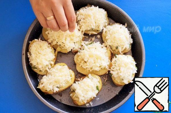 We put it back in the skin, sprinkle cheese on top and send it to the oven for another 15-20 minutes so that the cheese melts and browns.