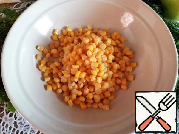 Drain the water from the corn.