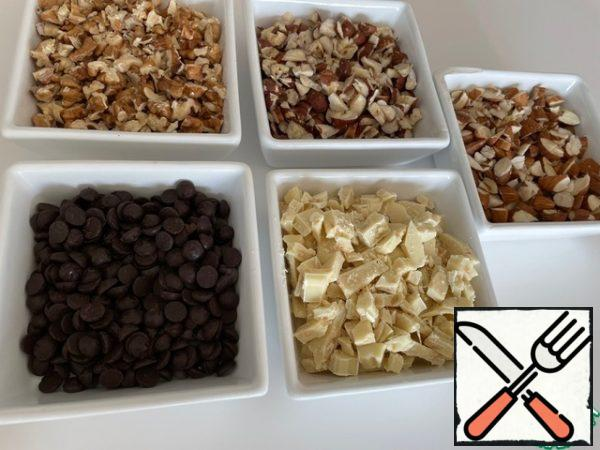 We prepare five types of fillings: nuts and chocolate are cut with a knife into separate containers.