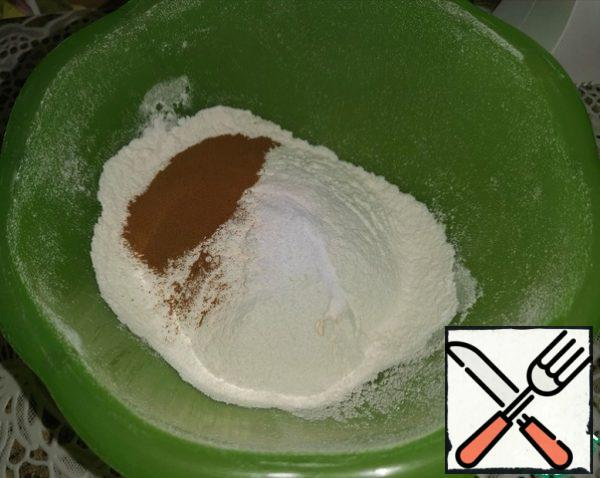 Sift flour, pour in coffee, soda and mix well.