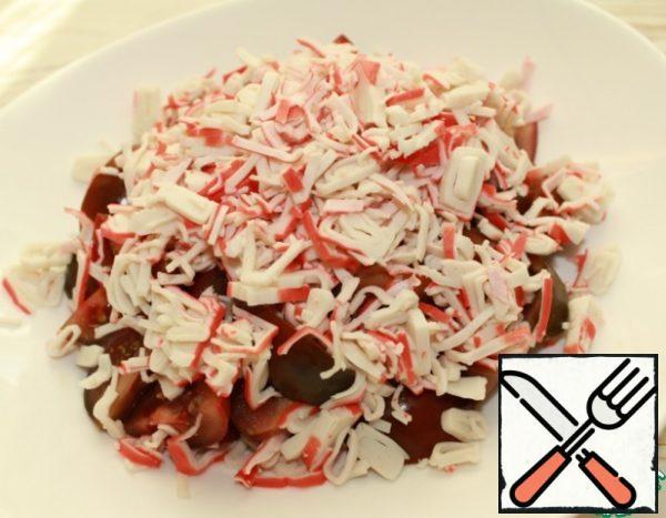 Then add the chopped crab sticks.